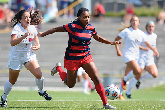 Metro Forward Regina Banks beats her defender towards the goal aginst CSUDH sept. 13 at the Regency Athletic Complex. Metro defeats Cal State 3-1. Photo by Abreham Gebreegziabher.
