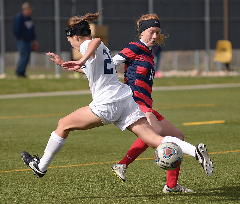 Metro defender Taylor Campbell ,right, stops forward Brooke Stoermer from advancing up field Nov. 6 against Colorado School of MInes at Stermole Soccer Stadium. Roadrunner's lost to Mines 1-2 in the semifinal.  Photo by Abreham Gebreegziabher • agebreeg@msudenver.edu
