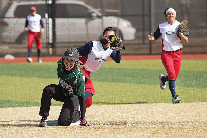 Metro freshman shortstop Ashlee Kim makes a catch covering second base but not in time to tag out ASU sophomore catcher Morgan Zanski.  Photo by Abreham Gebreegziabher • agebreeg@msudenver.edu